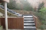 Aperçu de l'aménagement reprenant l'escalier et ses finitions